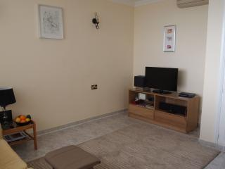 A spacious modern air conditioned lounge with Smart Satellite TV, iPod/phone player and DVD