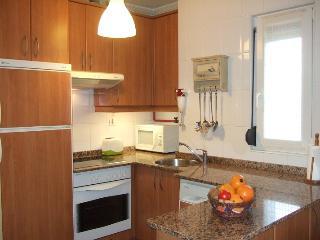 Apartamento LEIRE, Comillas, jardín con barbacoa, garaje y calefacción