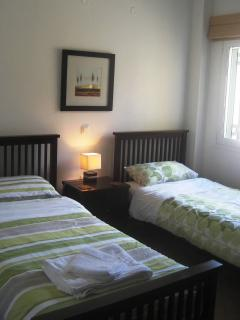 One of the twin bedded bedrooms