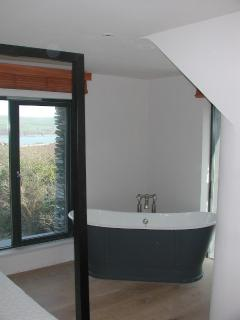 four poster bedroom with double ended bath