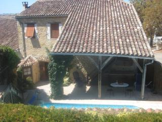 Rear of house, showing edge of pool and terrace - in the sun most of the day