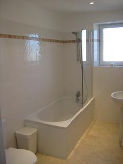 Large main bathroom with shower and deep bath