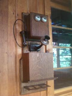 Antique telephone in entry porch