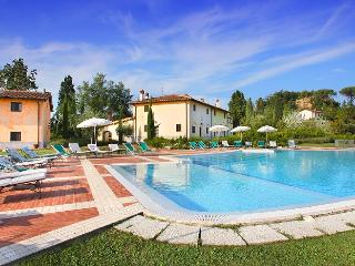 This terrific villa in the province of Florence boasts 8 independent suites that