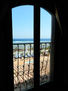 View from the French doors in the main bedroom to the swimming pool and sea!