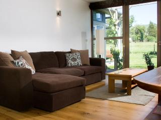 TV/AV room opens onto decking and lawn with views towards the mountains