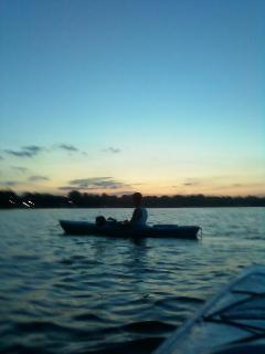 Kayaking at sunset on Webster Lake