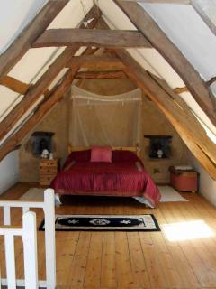 LOFT BEDROOM WITH ORIGINAL BEAMS SEA VIEWS AND EN SUITE.