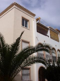 Outside of our 2nd floor Spanish style penthouse apartment with gardens lit all year round
