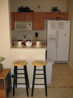 Breakfast bar next to kitchen