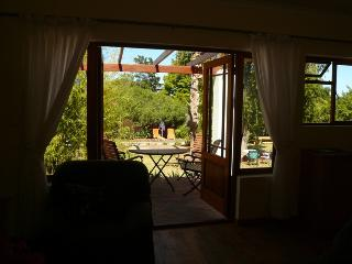 View from open-plan living room, across the rear terrace to pool