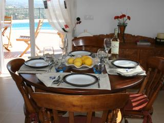 Dining area looking out to the pool and sea