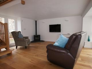 Lounge - seating for 4, Freesat Tv, DVD and Log burner.