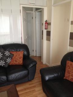 living area with two leather sofas. Dog friendly room.