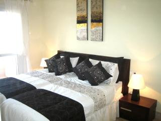 Superb spacious bedroom with quality furnishings, door leading to terrace overlooking golf course