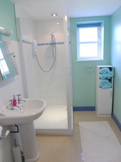 A large shower and heated towel rail make washing a pleasure