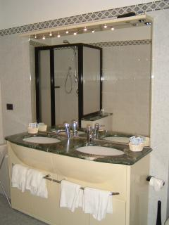 Second floor bathroom with bathtub and shower
