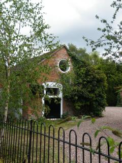 From the drive, the main stable and pitching eye-now the lounge with its round window
