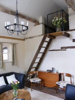 The hay loft remains and now with stairs for housekeeping use - Not for guests!