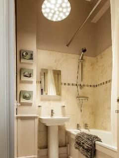 Modern bathroom with shaver point and light-up mirror