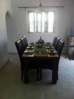 Dining area for 6.  Comfortable leather chairs around a good sized dining table.