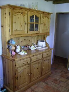 All the crockery and pots needed are in this large kitchen dresser
