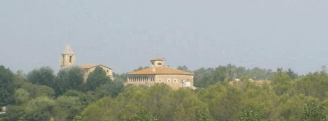 Distant view of the house and its veranda