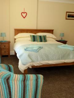 Our kingsize bedroom is spacious and light.