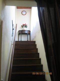 Polished wooden staircase to first floor