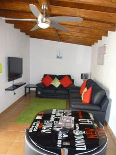 lounge/diner with tv, dvd/cd, 2 sofas and dining table with 4 chairs