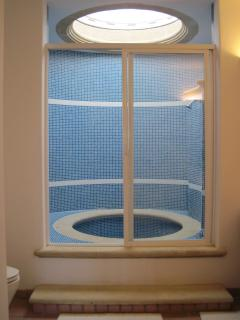 Newly tiled bath/shower in Ensuite Bedroom - pool level