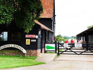 Onsite amenities include a Café, Riding School, Campsite, Animal Collection. 82 acres of meadows.