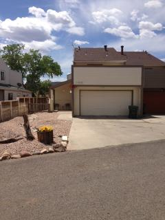 Front of the house with new rock landscaping, 2 car garage