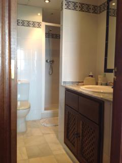 Well appointed bathroom , marble floors and tiled throughout