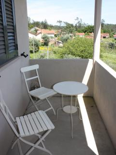 Balcony, with bistro table. Perfect for relaxing with a glass of wine!