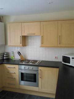 Fully equipped kitchen with door leading to private sunny rear garden. BBQ on request