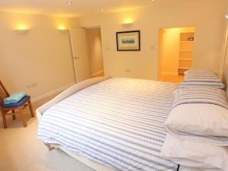 Quiet bedroom has a comfortable Super-King sized bed and a walk-in wardrobe.