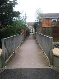 Bridge over the Chelt offers a shortcut to the shops in Tewkesbury Road.