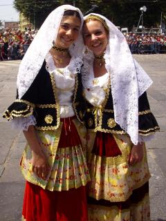 A warm Sard welcome is assured (Women is National Dress Feast St. Efiseo)