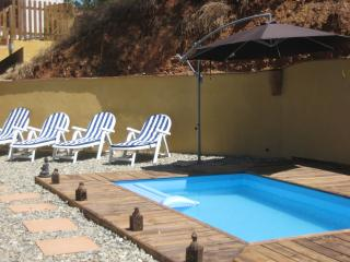 The gated pool area is to the left of the house, there are plenty of eucaliptus trees for shade.