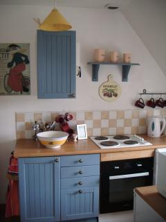 Fully equipped kitchenette. Open plan with sitting/dining area.