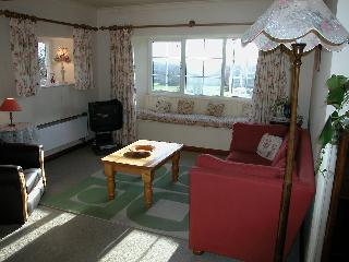 The sitting room overlooks the valley below