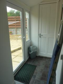 Utility area and back door leading to the washing line and patio area, in full sun most of the day