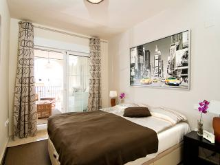 The master bedroom has an en-suite bathroom, direct terrace access, and ample storage