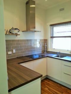 Newly renovated kitchen with dishwasher, induction hob, over, grill, microwave, bar/wine fridge
