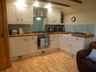 A modern, fully equipped kitchen fitted in June 2014 featuring a solid oak worktop