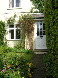 Front entrance porch and pretty, secluded garden