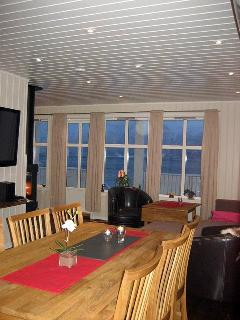 Dining & seating area with fjord & mountain views