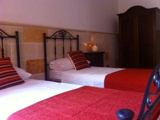 Second bedroom with single beds looking over to the courtyard area