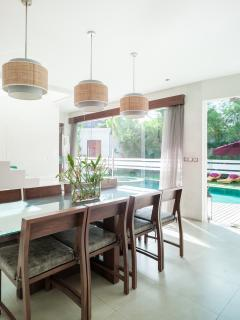 It consists of one spacious living and dining area, an open space kitchen, entertainment room .